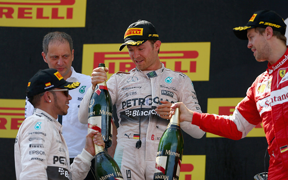 MONTMELO, SPAIN - MAY 10:  Nico Rosberg of Germany and Mercedes GP celebrates on the podium with Lewis Hamilton of Great Britain and Mercedes GP and Sebastian Vettel of Germany and Ferrari after winning the Spanish Formula One Grand Prix at Circuit de Catalunya on May 10, 2015 in Montmelo, Spain.  (Photo by Clive Mason Getty)