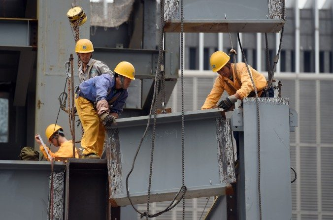 Obreros de construcción en Beijing, septiembre de 2015.  (Greg Baker/AFP/Getty Images)