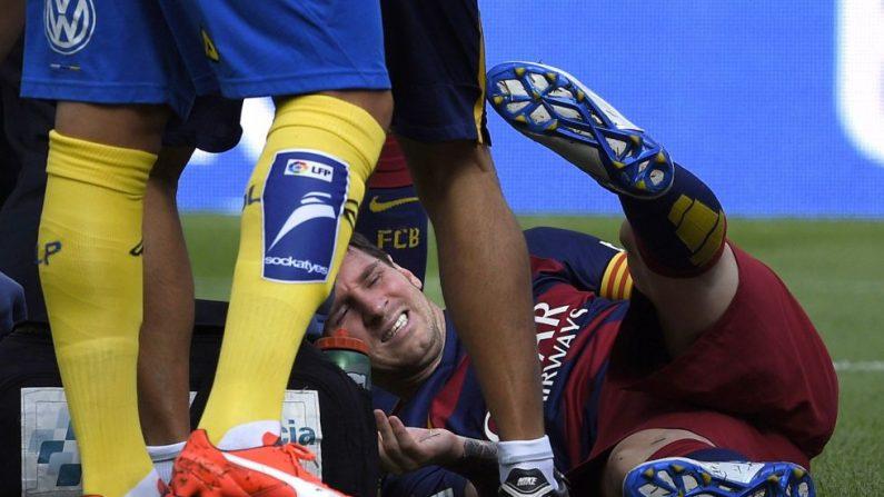Messi sufrió una lesión en el arranque del juego ante Las Palmas. Foto (AFP/Getty Images)