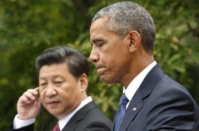 El presidente estadounidense Barack Omaba junto al cabecilla chino Xi Jinping en una conferencia de prensa luego de su reunión en la Casa Blanca, el 25 de septiembre de 2015. (YURI GRIPAS/AFP/Getty Images)