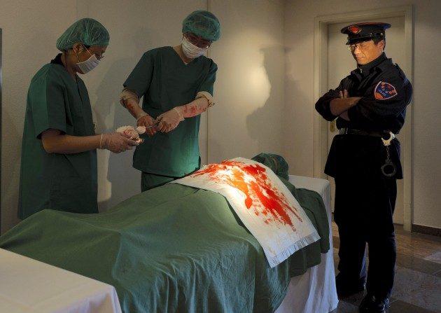 Recreación del acto de  sustracción de órganos en China (Robert Michael / AFP / Getty Images)