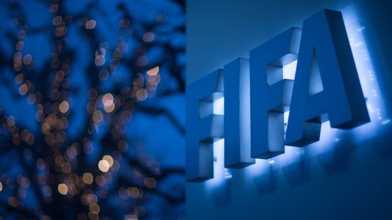 Logo iluminado de la FIFA en la sede FIFA en Zúrich, Suiza. Detienen ex dirigente de fútbol involucrado en escándalo de FIFA en El Salvador. (Philipp Schmidli/Getty Images)