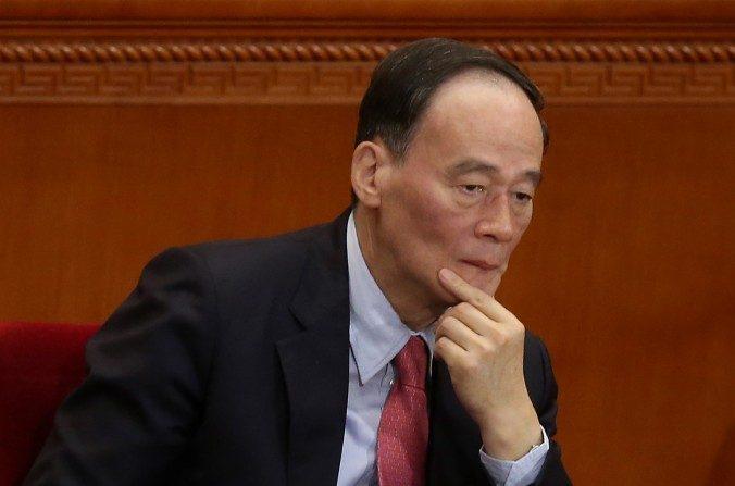 Wang Qishan en la sesión de apertura del Congreso Nacional del Pueblo el 5 de marzo de 2014. (Feng Li/Getty Images)