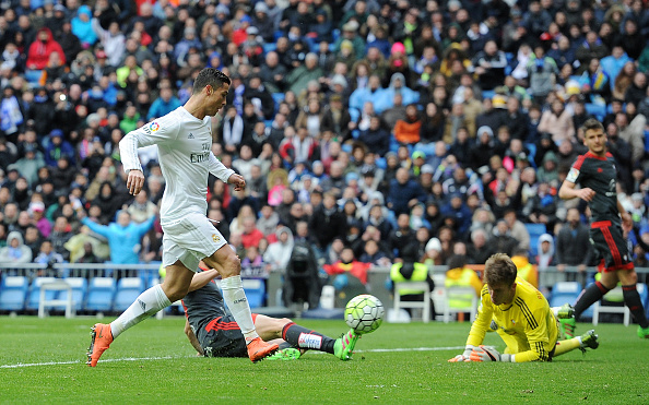 Cristiano Ronaldo of Real Madrid scores his 3rd goal against Ruben Blanco of Celta Vigo during the La Liga match between Real Madrid CF and Celta Vigo at Estadio Santiago Bernabeu on March 5, 2016 in Madrid, Spain. (Photo by Denis Doyle/Getty Images)
