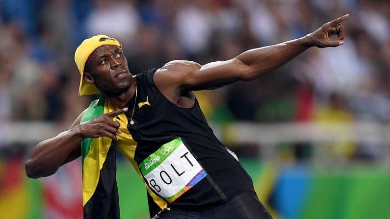 Usain Bolt de Jamaica celebra ganando la carrera de hombres 100m en Río de Janeiro, Brasil. (Shaun Botterill/Getty Images)