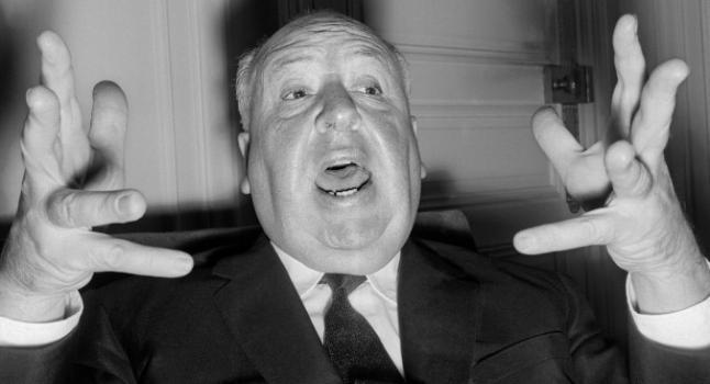 Alfred Hitchcock, director de cine británico (1899-1980), expresa con gestos mientras da una conferencia de prensa en París para presentar su última película 'Psycho' el 18 octubre de 1960. Dando su tópico elegido, es una extraña coincidencia que habría cumplido 100 años en un viernes 13. ( STF / AFP / Imágenes Getty)
