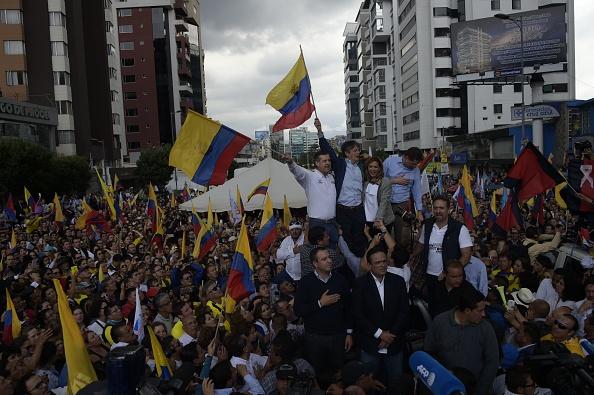 El escrutinio ha alcanzado 95,52% del total, con Moreno acumulando 39,22% de los votos y Lasso 28.34%. La segunda ronda sería el 2 de abril. (Foto: RODRIGO BUENDIA/AFP/Getty Images)