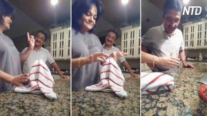 Mujer llama a su esposo para mostrarle un truco de magia; observa de cerca cuando levanta la toalla