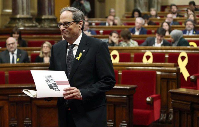 El presidente autonómico de Cataluña, Quim Torra, nombró hoy como miembros de su gobierno a dos independentistas encarcelados y a otros dos que están en Bélgica prófugos de la Justicia española.