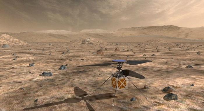 Imagen artística del helicóptero Marte de la NASA, una pequeña aeronave autónoma de alas giratorias que viajará junto al explorador Marte 2020 de la agencia.Pasadena, California, Estados Unidos. 11 de mayo, 2018. Cortesía de NASA/JPL-Caltech/Handout via REUTERS ATENCIÓN EDITORES - ESTA IMAGEN FUE BRINDADA POR UNA TERCERA PARTE