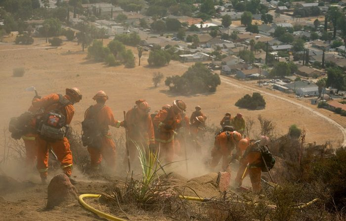 Hand crews work on the fire line of the Holy Fire in Lake Elsinore, California, southeast of Los Angeles, on August 11, 2018. - The fire has burned 21,473 acres and was 29 percent contained as of 8:30 a.m. Saturday, according to the Cleveland National Forest. (Photo by RINGO CHIU / AFP)        (Photo credit should read RINGO CHIU/AFP/Getty Images)