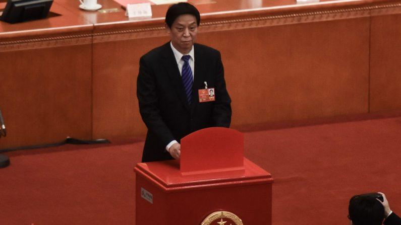 Li Zhanshu, presidente del Comité Permanente de la Legislatura china, Congreso Nacional del Pueblo en una sesión en el Gran Salón del Pueblo en Beijing, China, el 18 de marzo de 2018. (Foto de Etienne Oliveau/Getty Images)