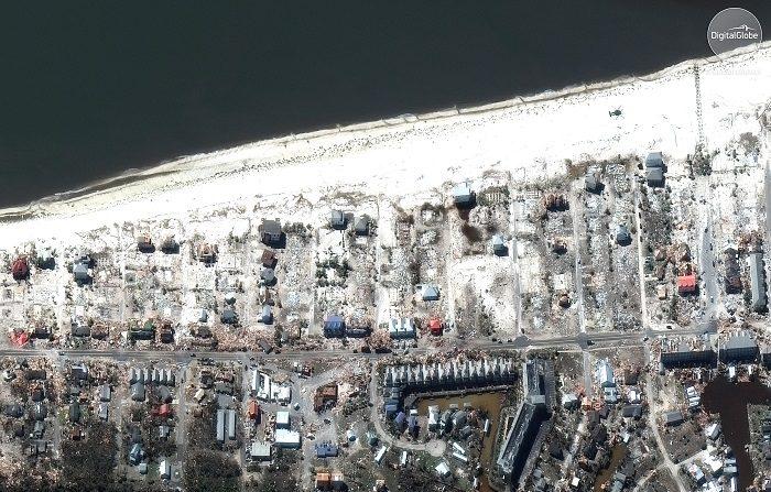 Fotografía satelital, distribuida este sábado por DigitalGlobe, en la que se registró el muelle de una playa en la Ciudad de México Beach (Florida, EE. UU.), luego del paso devastador del huracán Michael por la zona. EFE