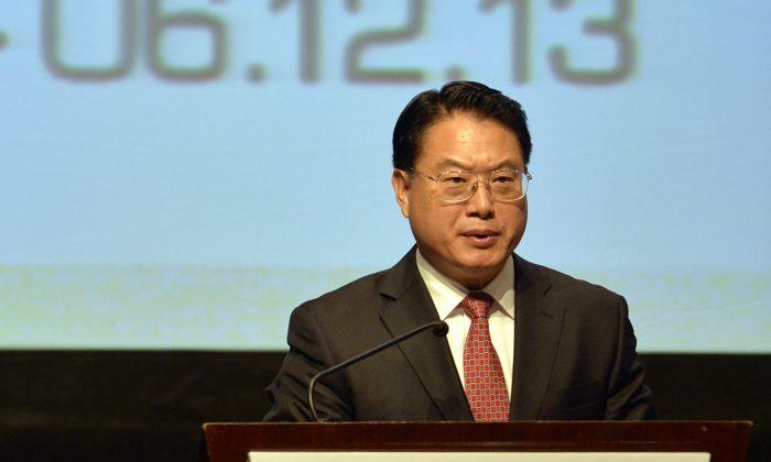 Li Yong, director general de la Organización de las Naciones Unidas para el Desarrollo Industrial (ONUDI), participa en un evento de la ONUDI en Lima, Perú, el 2 de diciembre de 2013. (Cris Bouroncle/AFP/Getty Images)
