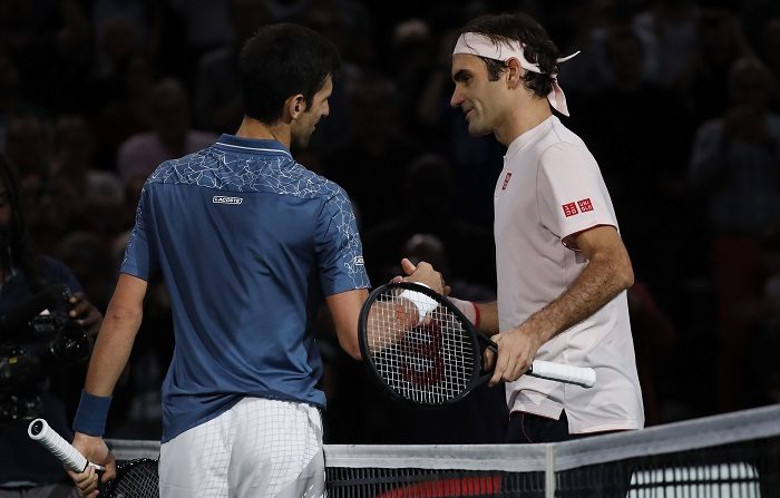 Roger Federer of Switzerland (R) congratulates Novak Djokovic of Serbia after their semifinal match at the Rolex Paris Masters tennis tournament in Paris, France, 03 November 2018. (Tenis, Francia, Suiza) EFE/EPA/CHRISTOPHE PETIT TESSON