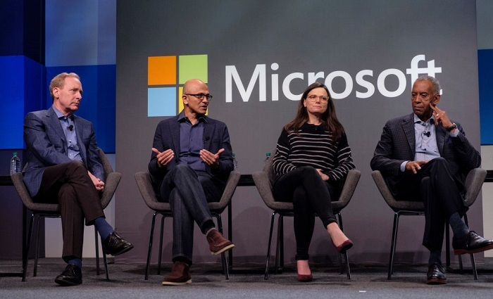 Microsoft CEO Satya Nadella, second from left, answers a shareholders question while President and Chief Legal Officer Brad Smith, Executive Vice President and CFO Amy Hood and Board Chairman John Thompson listen during the Microsoft Annual Shareholders Meeting at the Meydenbauer Center on November 28, 2018 in Bellevue, Washington. Microsoft recently surpassed Apple, Inc. to become the world's most valuable publicly traded company. (Photo by Stephen Brashear/Getty Images)