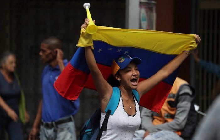 Cubanos en Miami respaldan las protestas venezolanas para desalojar a Maduro. EFE/Miguel Gutiérrez