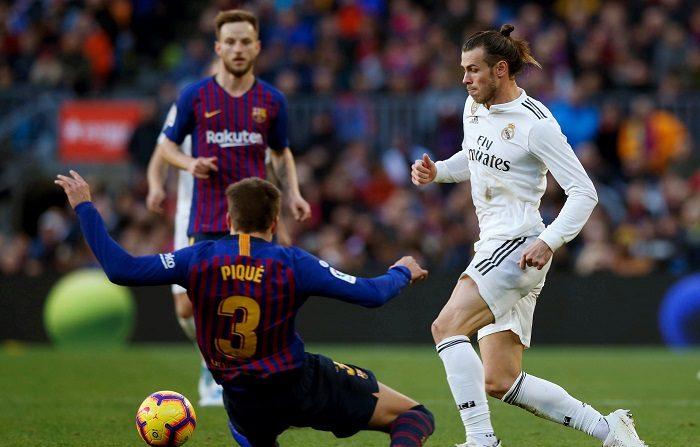 Betis-Valencia y Barcelona-Real Madrid son las semifinales de la Copa del Rey, según ha deparado el sorteo celebrado este viernes en el estadio Benito Villamarín, sede de la final copera el próximo 25 de mayo. EFE/Enric Fontcuberta.