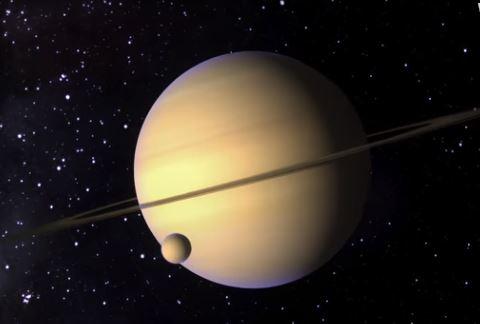 Saturno y la Luna Titan. (NASA)