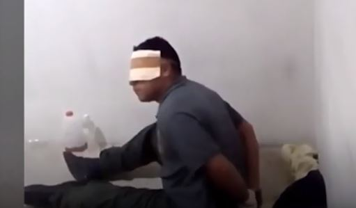 Captura de vídeo presentado como prueba de tortura en El Calabozo, Caracas ante la OEA el 20 de marzo de 2019. (La Gran Época)