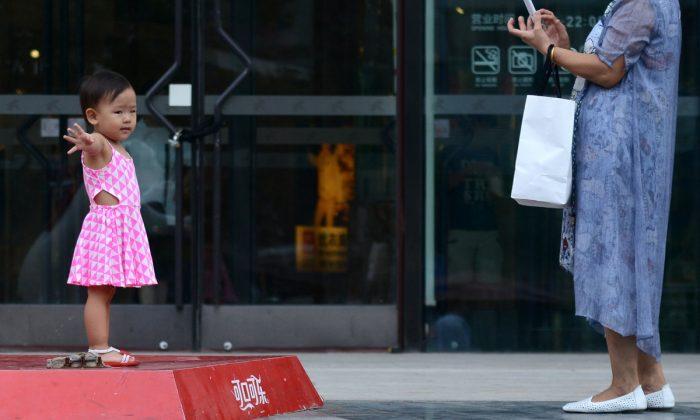 NIña china posando para una foto. (WANG ZHAO/AFP/Getty Images)