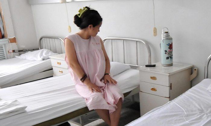 Una mujer en una sala de obstetricia en China. (Frederic J. Brown/AFP/Getty Images)