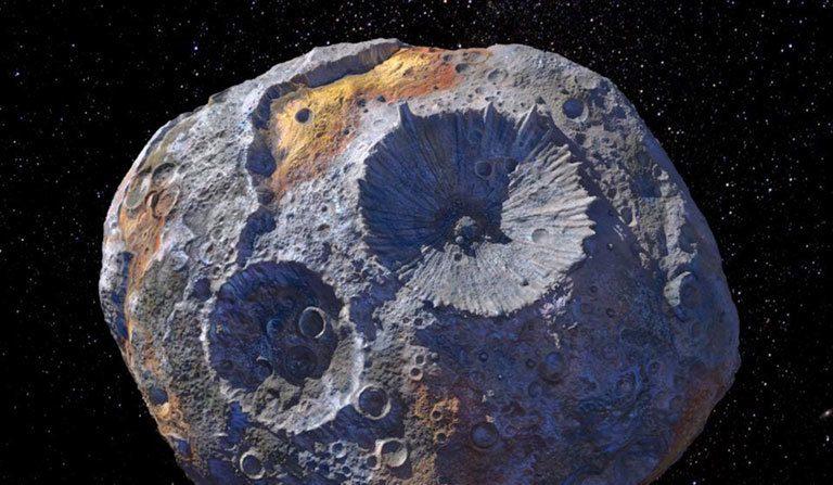 Concepto de artista del asteroide 16 Psique, que se cree que es un núcleo planetario desnudo. Fotografía: Maxar/ASU/P. Rubin/NASA/JPL-Caltech