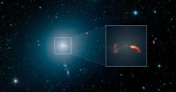La galaxia M87, del telescopio espacial Spitzer de la NASA, es el hogar de un agujero negro supermasivo. Créditos: NASA/JPL-Caltech/IPAC.