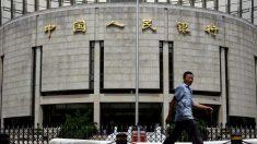 Banco Popular de China reduce los activos de divisas en un tercio