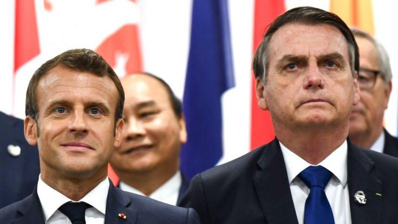 O presidente da França, Emmanuel Macron, e o presidente do Brasil, Jair Bolsonaro, participam de um evento sobre o empoderamento das mulheres durante a Cúpula do G20 em Osaka, em 29 de junho de 2019 (Brendan Smialowski / AFP / Getty Images)