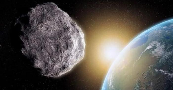 La obra de un artista muestra un asteroide cerca de la Tierra. (NASA)