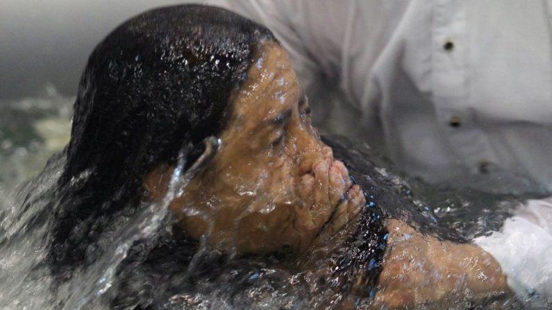 Imagen de archivo de un bautizo. (ULISES RUIZ/AFP/Getty Images)