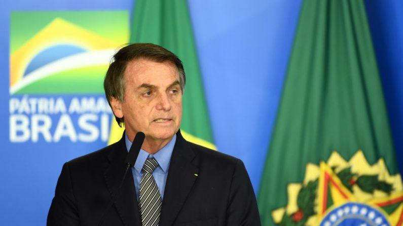 O presidente do Brasil, Jair Bolsonaro, proferiu um discurso durante uma cerimônia para aprovar a Lei de Liberdade Econômica no Palácio do Planalto, em Brasília, em 20 de setembro de 2019 (Foto: EVARISTO SA / AFP / Getty Images)