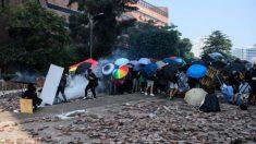 Policía de Hong Kong suspende ley anti-máscara mientras persiste la violencia en la Universidad