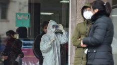 China amplía los cierres, clausura sitios turísticos y el número de muertes por virus aumenta a 26