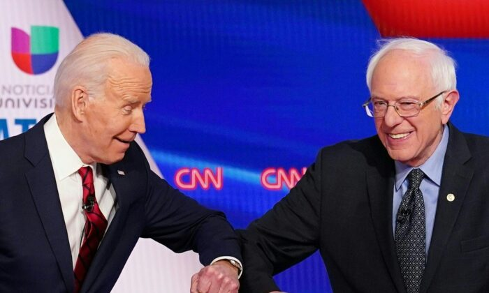 Los aspirantes presidenciales demócratas, el ex vicepresidente de Estados Unidos Joe Biden (izq.) y el senador Bernie Sanders se saludan, antes del inicio del 11º debate presidencial del Partido Democrático 2020, en un estudio de la Oficina de Washington de CNN, en Washington, el 15 de marzo de 2020. (Mandel NGAN/AFP a través de Getty Images)