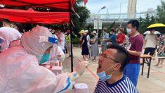 China: Xinjiang impulsa más medidas de bloqueo para contener virus, provocando la ira de los residentes