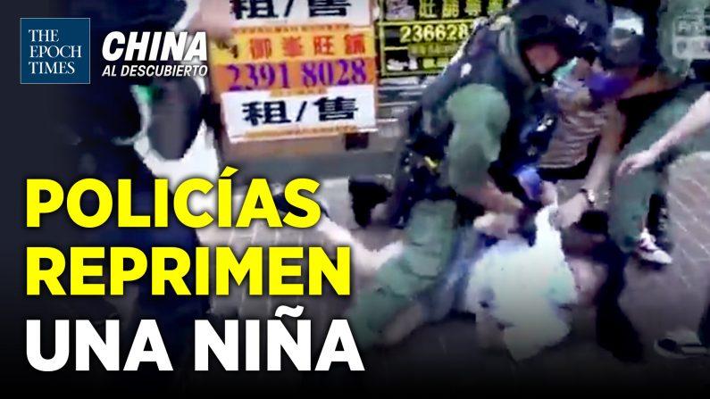 La policía de Hong Kong acorrala y detiene una niña de 12 años. (China al Descubierto/The Epoch Times en Español)