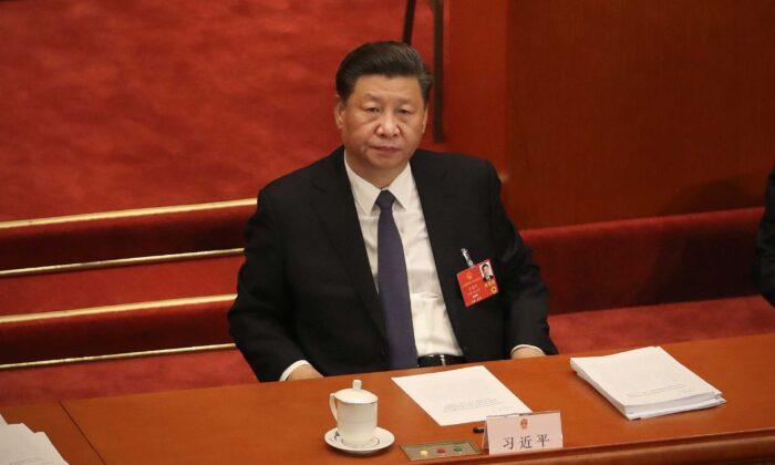 El líder chino Xi Jinping asiste a la inauguración del Congreso Nacional del Pueblo, en el Gran Salón del Pueblo, en Beijing, China, el 22 de mayo de 2020. (Andrea Verdelli/Getty Images).