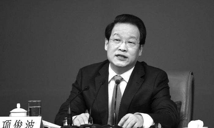 Xiang Junbo, presidente de la Comisión Reguladora de Seguros de China (CIRC) en el Congreso Nacional del Pueblo en Beijing el 12 de marzo de 2016. (WANG ZHAO/AFP/Getty Images)