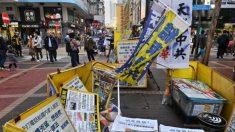 Vándalos con presuntos vínculos con Beijing atacan stands de practicantes de Falun Dafa en Hong Kong