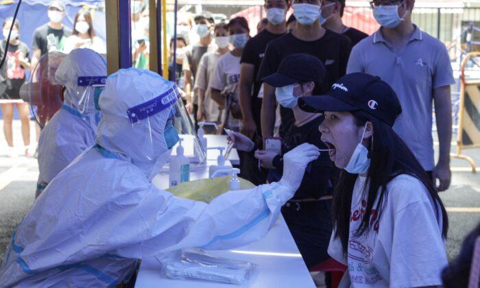 Resurge el COVID-19 en ciudades de Guangdong, China, a pesar de los bloqueos draconianos