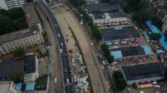 Recuperan cadáveres de túnel sumergido por inundaciones en el centro de China