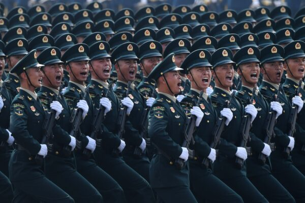 Chinese troops march during a military parade