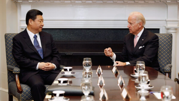 Then U.S. Vice President Joe Biden (R) and Chinese Vice President Xi Jinping