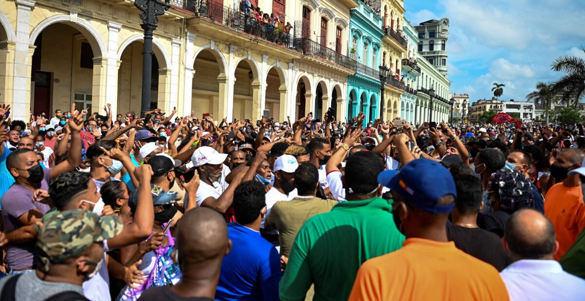 People take part in a demonstration against the government