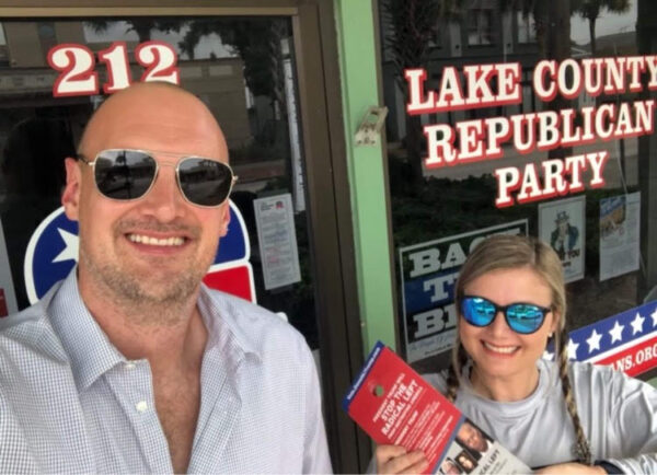 """Charles and Jessico Bowman participating in the October """"ground game"""" ahead of the 2020 election in Lake County, Fla."""